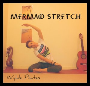 MERMAID STRETCH: lumbar spine, quadratus lumborum (lower back)